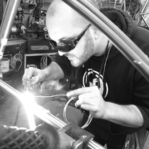 Dan P. welds in our frame shop